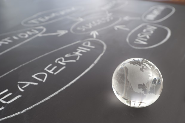 Flowchart on a chalk board with world globe